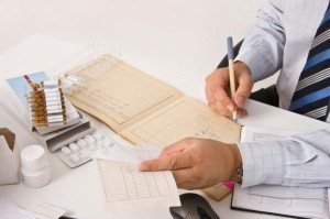 person-signing-regulatory-documents-at-desk
